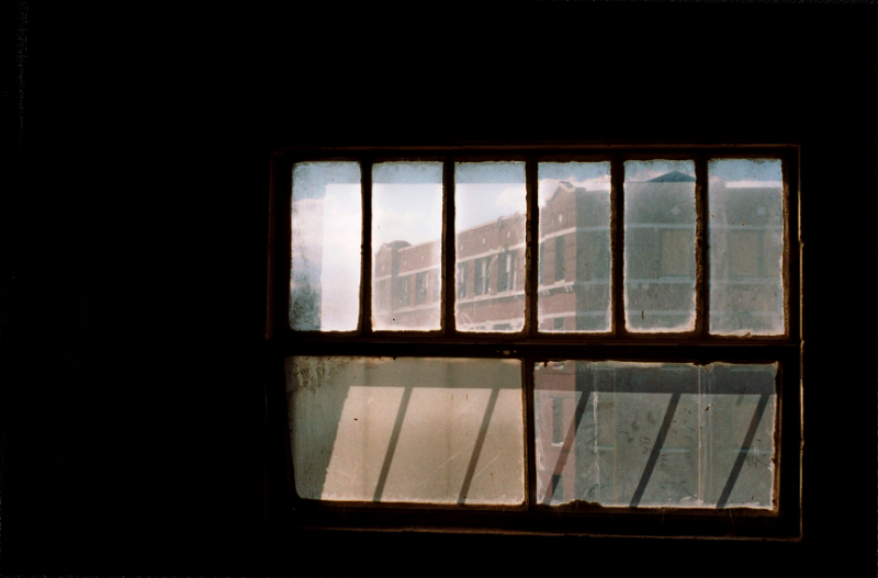 film photograph dark shadows chiaroscuro abandoned building window