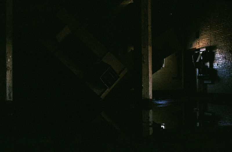 film photograph dark shadows chiaroscuro abandoned building water reflection