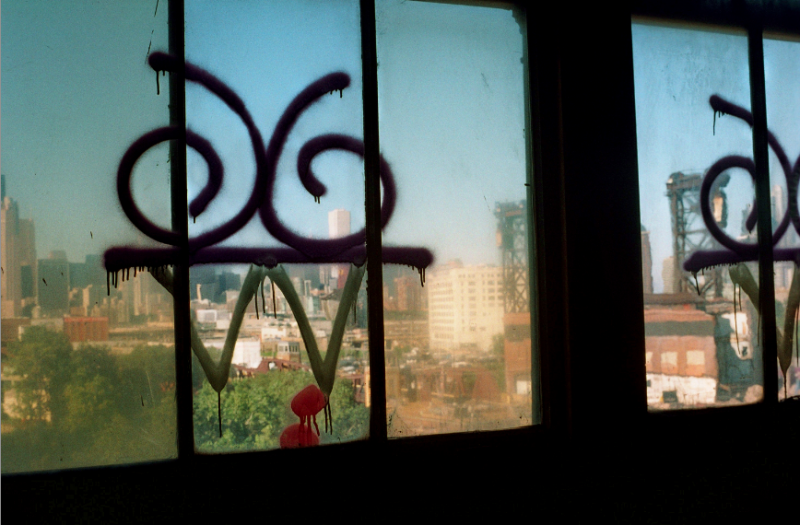 film photograph dark shadows chiaroscuro abandoned building graffiti window
