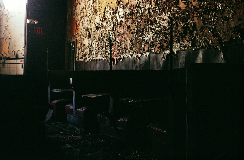 abandoned building film photography restaurant peeling paint fire tables