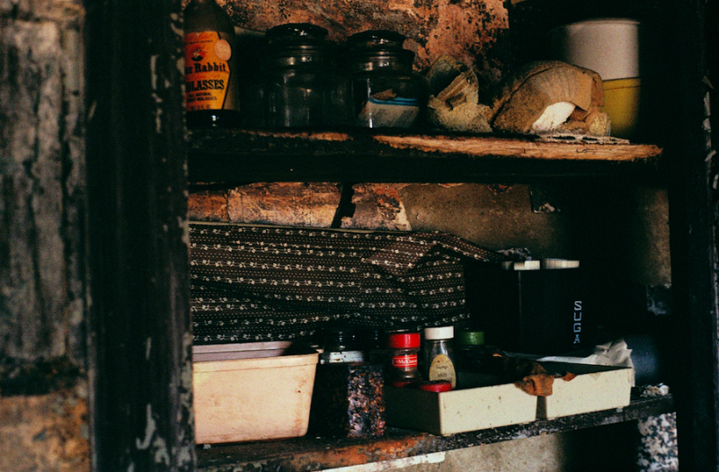 abandoned building film photography kitchen spices molasses shelf pantry food