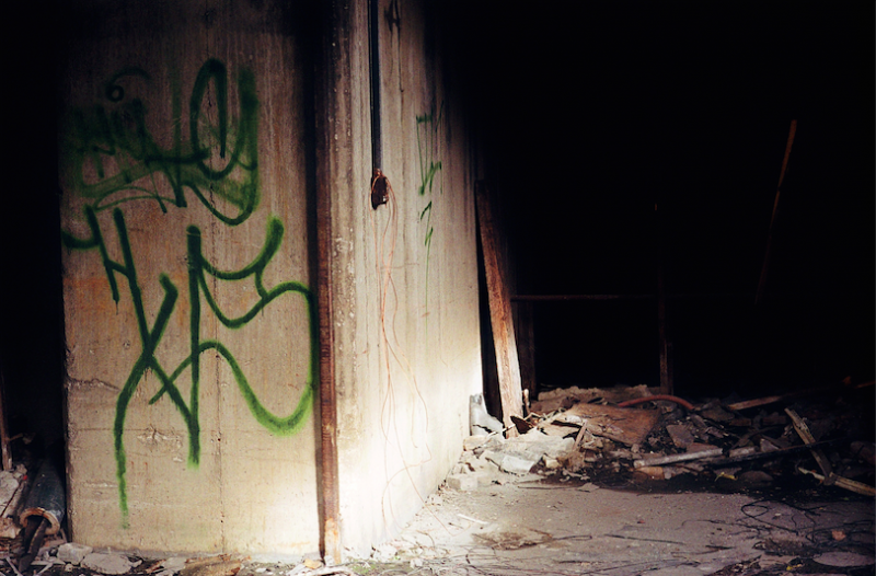 abandoned building film photograph graffiti wall shadow dark
