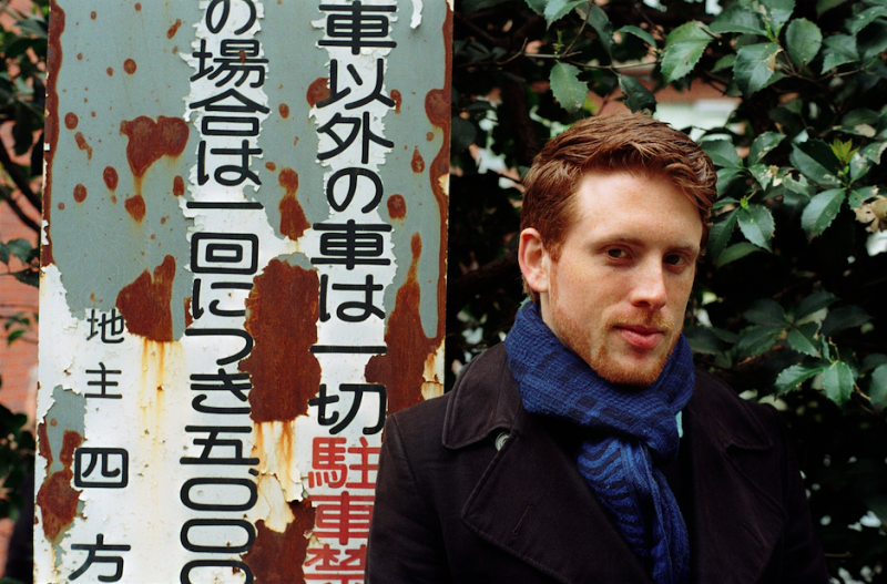 film photograph portrait young man red hair ginger blue scarf handsome japan street sign foliage