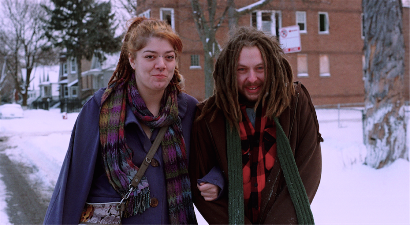 film photograph portrait winter snow couple smiling linked arms dreadlocks redhead plaid colorful adorable cute