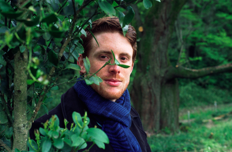 film photograph portrait young man red hair ginger blue scarf handsome woodlands nature leaves trees