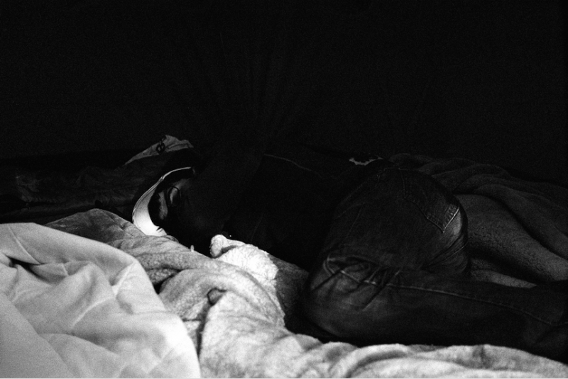 film photograph black and white young man boy napping chiaroscuro