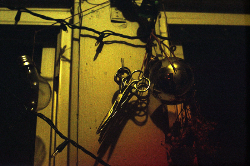 film photograph dark shadow scissors hanging