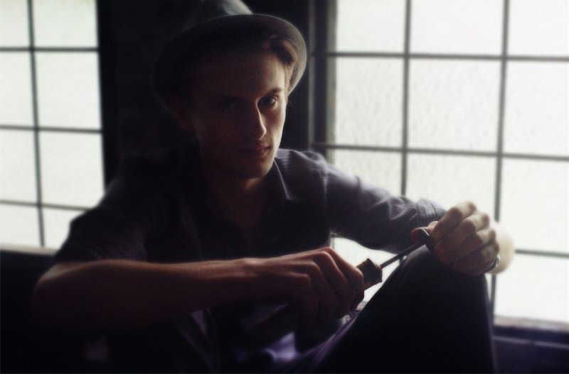 film bokeh photograph portrait young man fedora tool screwdriver pensive