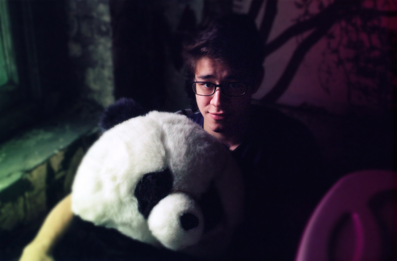 bokeh film photograph portrait young man stuffed panda cute