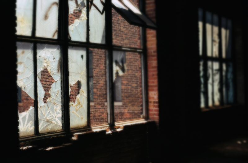 film photograph abandoned building urbex broken window panes glass