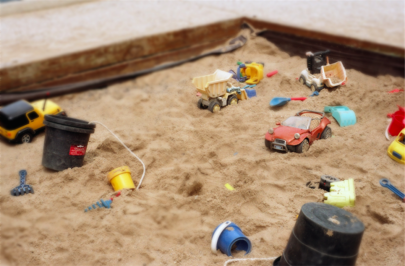 film photograph sandbox childrens toys cars bucket shovel truck