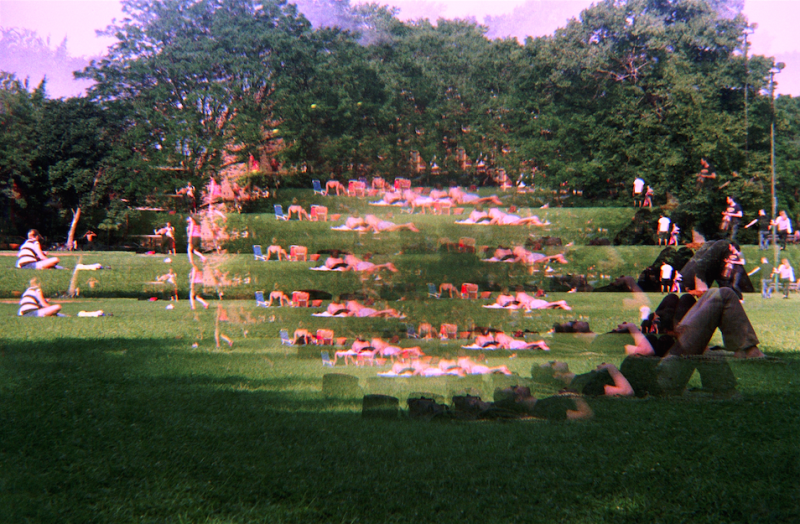 film photograph trippy psychedelic prism lens park people playing soccer relaxing