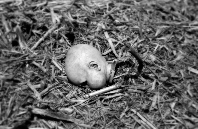 film photography urbex abandoned ruinporn baby doll head ground creepy