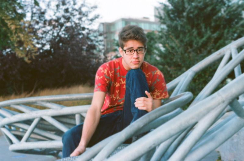 film photograph portrait young man autumn sitting hapa glasses