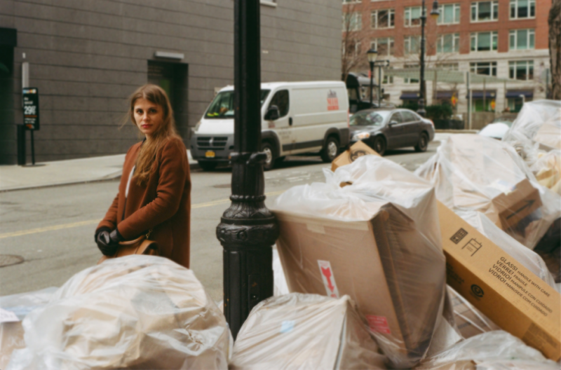 film photograph portrait young woman long hair blonde bokeh trash new york street bags