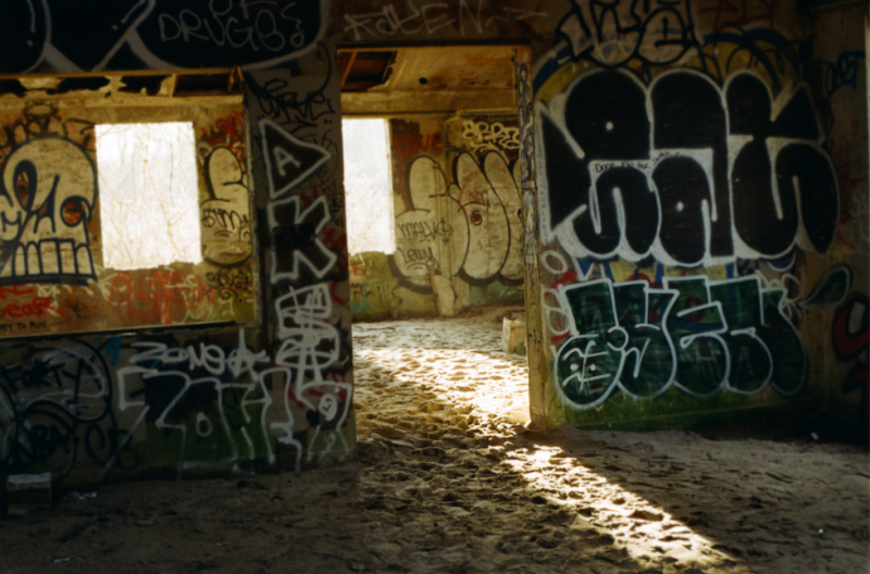 film photography urbex abandoned crumbling debris ruinporn sand graffiti