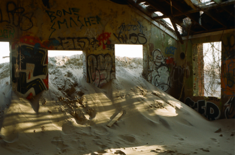 film photography urbex abandoned crumbling debris ruinporn sand graffiti sunlight