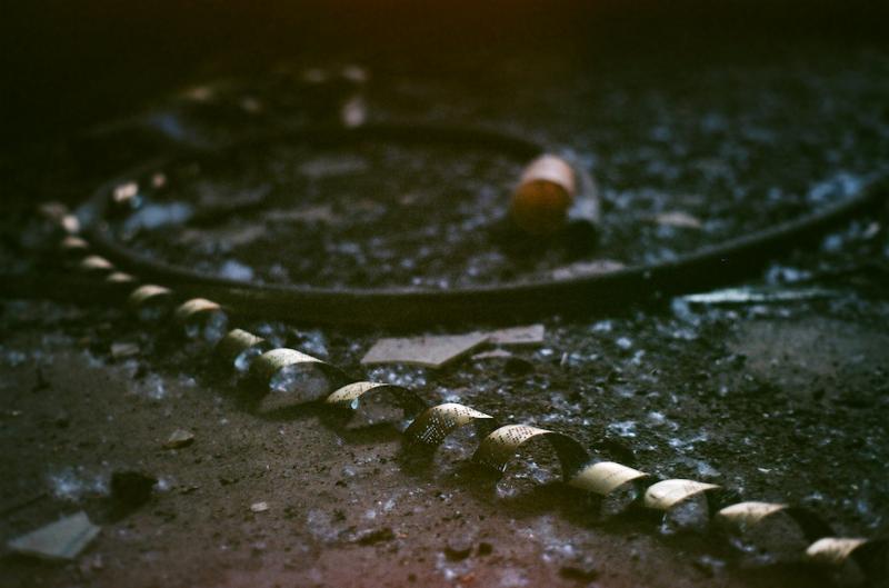 film photography urbex abandoned ruinporn crumbling debris screw and bolt factory tape