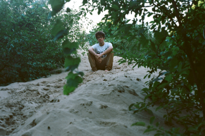 film photograph portrait young man hapa dunes sand sitting trees leaves hill