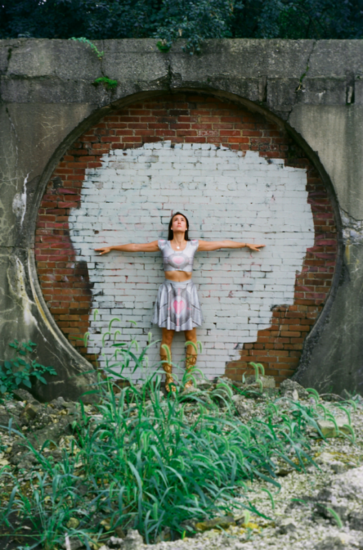 film photograph portrait young woman girl cosplay companion cube wall bricked in circle nature urbex