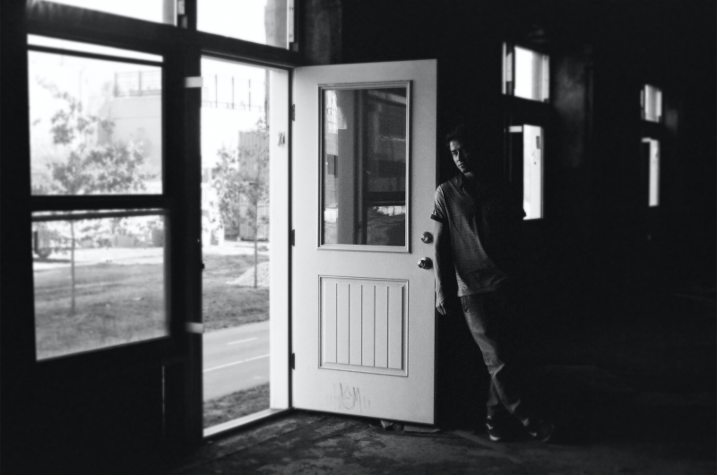 film photograph urbex abandoned black and white portrait door