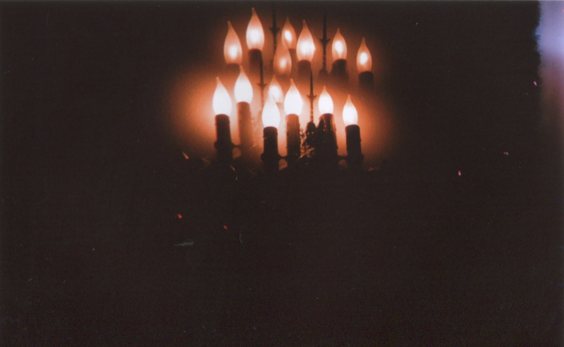 film photograph candles reflection dark glow shadow