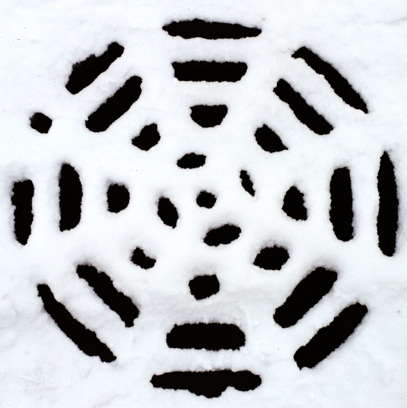 film photograph winter snow covered manhole