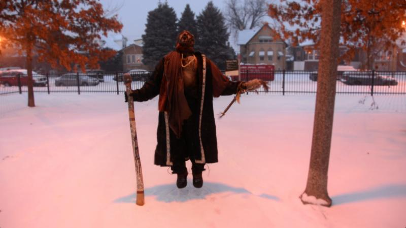 portrait snow winter park jumping man didgeridoo