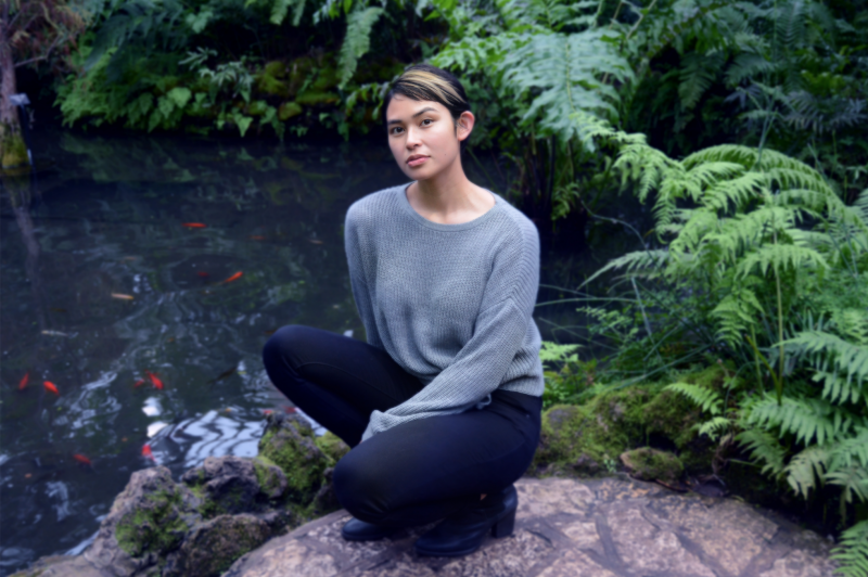 digital photograph portrait model plants conservatory hothouse leaves girl young woman sitting asian sweater short hair pixie cut pond fashion goldfish koi