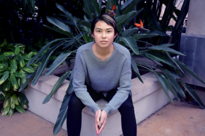 digital photograph portrait model plants conservatory hothouse leaves girl young woman sitting asian sweater short hair pixie cut fashion