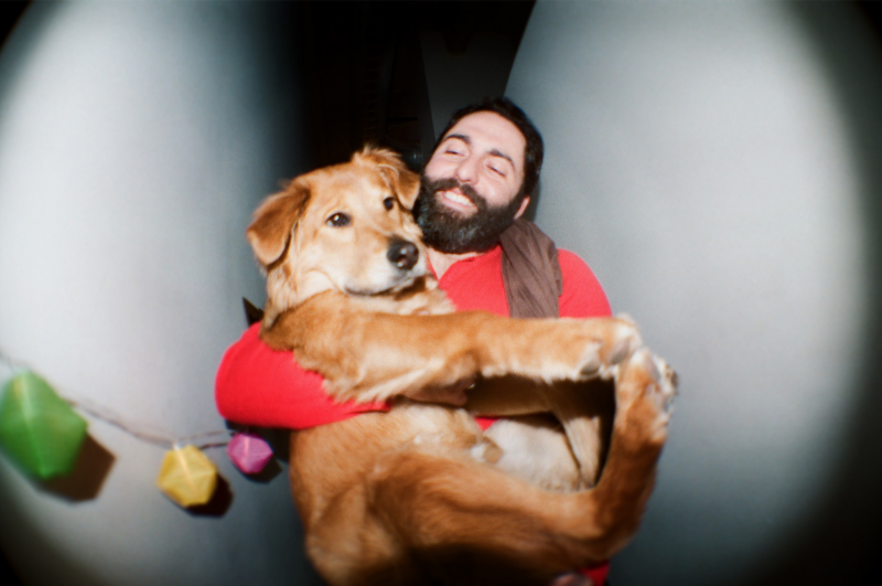 fisheye lens portrait man carrying dog puppy german shepherd chow chow mix