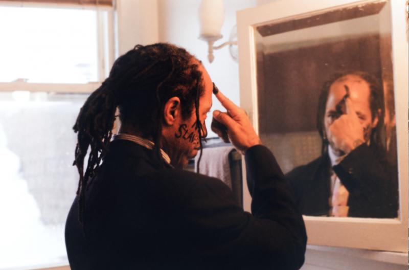 portrait african american man dreadlocks suit face paint charcoal no slaves