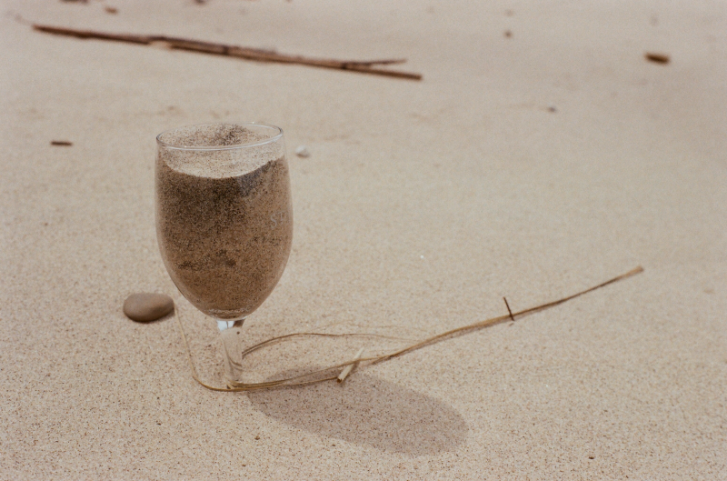 sand beach wine glass buried still life