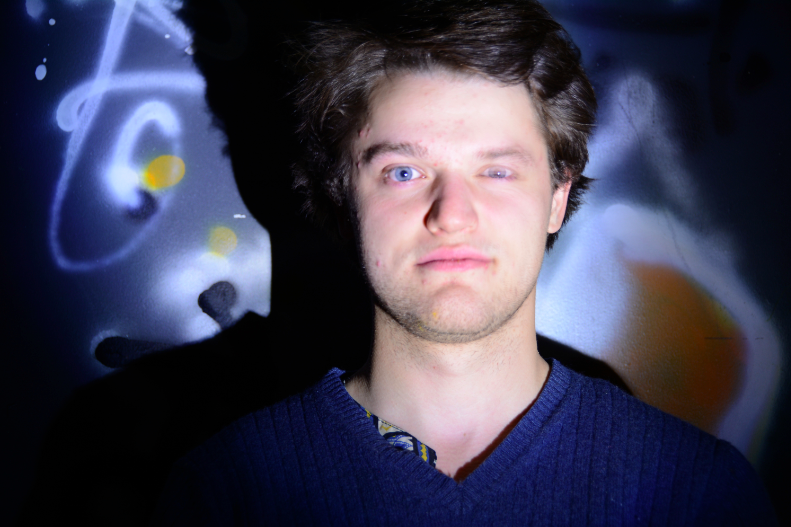 digital photograph young man blue sweater orange graffiti creepy surreal weird one eye blinking double exposure