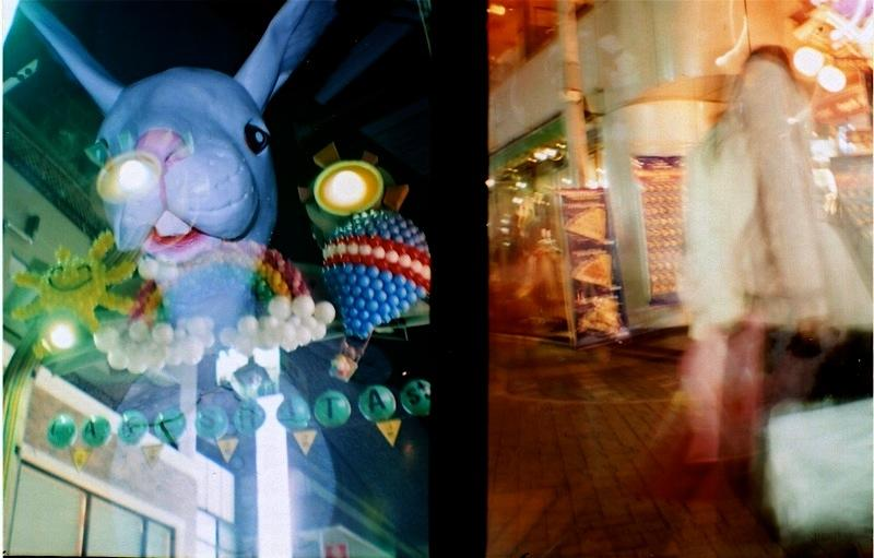 film photographs of a busy tokyo street light dark chiaroscuro lomography colors colorful bright splash flash blur people surreal weird bizarre shopping