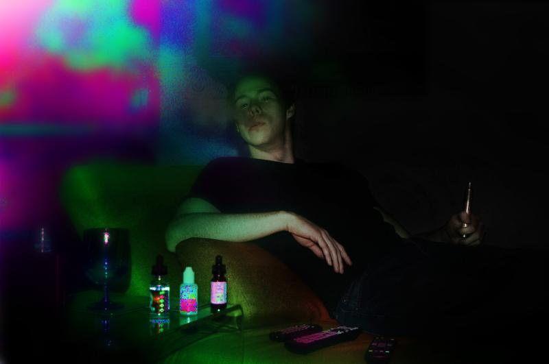 film photograph portrait young man vape mech mod juice bottles cloud psychedelic trippy neon colorful
