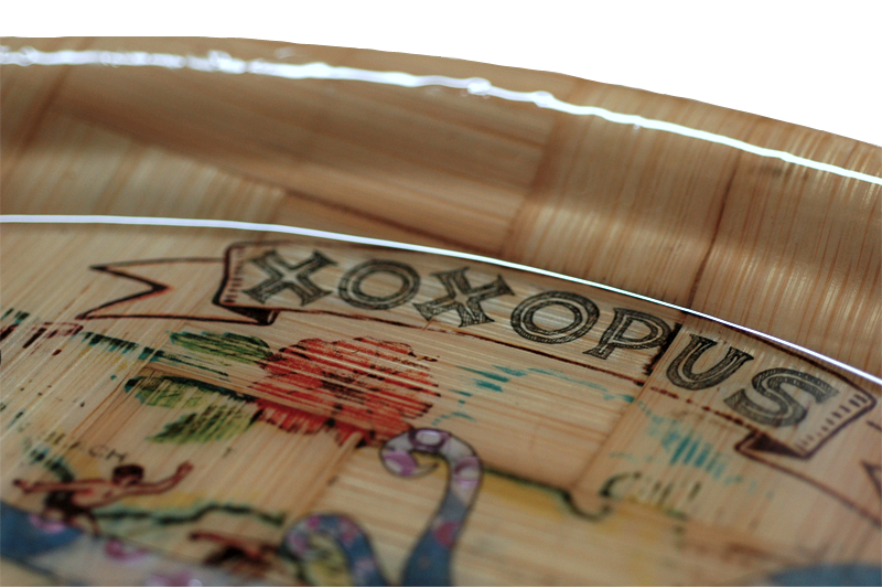 "a wooden oval tray with a vintage style decoupage ""xoxo"" escher geometric print blue and white octopus design, with glitter x's and o's on the tentacles and faded flower pattern"