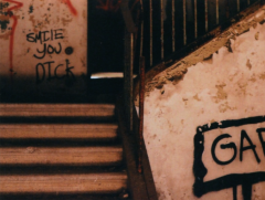 film photograph dilapidated staircase creepy scary dark shadows smile you dick graffiti gary post office