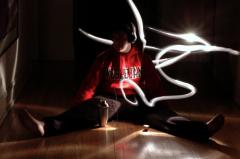 light portrait photography shadow dark white streak movement flash man boy sitting straddle puzzled hallway wooden floor headphones cocktail shaker wesleyan sweatshirt red strange surreal weird