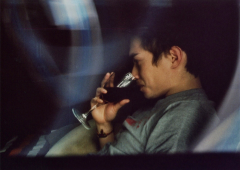 """long exposure photograph """"light portrait"""" of young man with glass of red wine streaky vintage lomography old blur"""