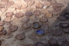 digital photograph ground dirt bottle caps rusted old one new shiny blue contrast modern art pattern graphic