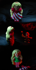 light portrait triptych dark shadow contrast chiaroscuro weird bizarre funny creepy white red lighting flash blur streak whirl vintage plastic doll toy red white striped dress blonde curly hair locks headband windup monkey fez turkish green dress polka dots