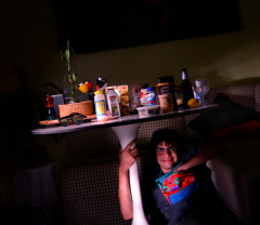 digital photograph light portrait chiaroscuro dark light contrast flash glow creepy surreal weird bizarre strange modern young man dark hair brunette boy kitchen table white round food lunchbox smiling lucky bamboo honey royal jelly glass beer pepper sunglasses still life