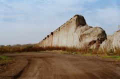 film photograph blue skies empty field dirt road great wall abandoned stone old factory steel mill crumbling gigantic massive castle fort perspective