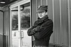 black and white film portrait photograph vintage retro WWII uniform young man winter snow smoking cigarette cap