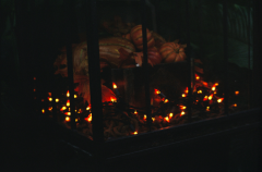 film photograph pumpkins light string holiday christmas orange warm glowing glass reflection cheery cozy