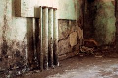 film retro vintage crumbling wall pipes paint green peeling disrepair falling apart old