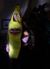 digital photograph young man banana del monte costume suit holding stuffed monkey ape gorilla scowl surreal stare shadows chiaroscuro lighting