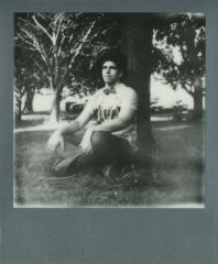 polaroid film retro vintage black white young man top hat tree park sitting bow tie