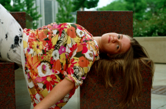 film photograph portrait girl lying big floral shirt